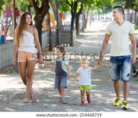 Parents with children  holding vacation day outdoor - stock photo