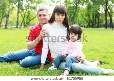 Parents with daughter together in the summer park