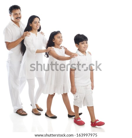 Parents with their children standing in a row - stock photo