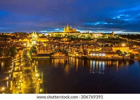 Pargue at dusk, view of the Lesser Bridge Tower of Charles Bridge (Karluv Most) and Prague Castle, Czech Republic. - stock photo