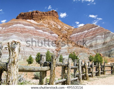Pariah Cliffs and Fence at a Western Movie Set, Utah - stock photo