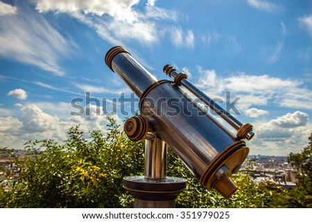 Paris aerial telescope view from Monmartre hill.