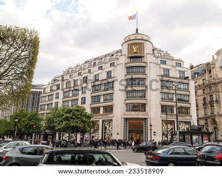 PARIS-APR 16: Customers are on queue to enter Louis Vuitton shop at Champs-Elys�©es on April 16,2012 in Paris, France.  Louis Vuitton is one of the world's leading international fashion houses. - stock photo