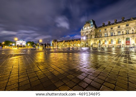 PARIS - APR 14 : Louvre museum at twilight in summer on April 14,2016. Louvre museum in rainy day.