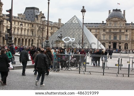PARIS - APRIL 27: At the Louvre museum on April 27, 2013 in Paris, France. Louvre is the most visited museum in the world, more 10 millions in 2014
