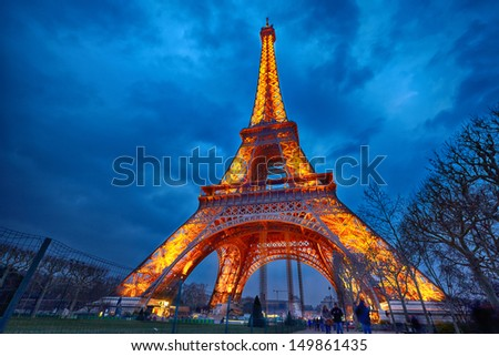 PARIS - APRIL 03: Closeup view on Eiffel Tower Light Beam Show on April 03, 2013 in Paris, France. The Eiffel tower is the most visited touristic attraction in France. - stock photo