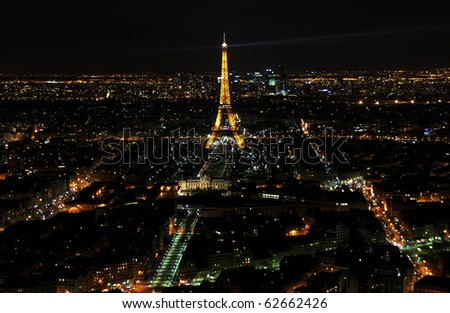 PARIS - APRIL 4: Eiffel Tower at night April 4, 2010 in Paris, France. Eiffel tower is the most visited monument of France and the most recognizable landmark of the world - stock photo