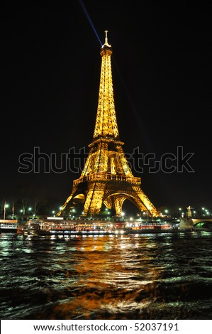 PARIS - APRIL 4: Eiffel tower at night on April 4, 2010 in Paris. Eiffel tower is the most visited monument of France. - stock photo