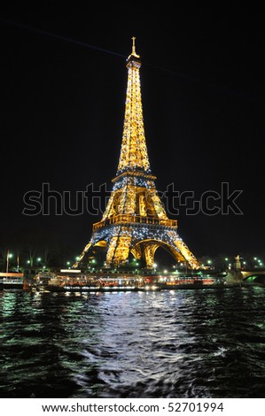 PARIS - APRIL 4: Eiffel tower at night on April 4, 2010 in Paris. Eiffel tower is the most visited monument of France.