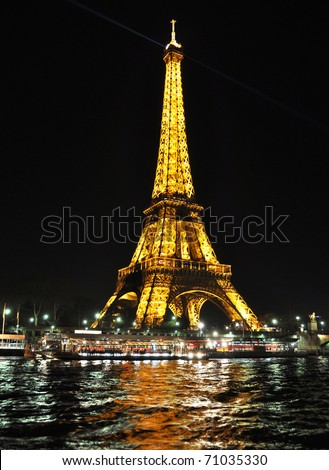 PARIS - APRIL 4: Eiffel tower at night on April 4, 2010 in Paris. Eiffel tower is the most visited monument of France - stock photo