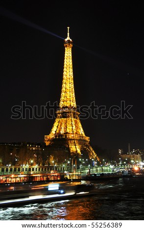 PARIS - APRIL 4: Eiffel tower at night on April 4, 2010 in Paris. The Eiffel tower is the most visited monument of France. - stock photo