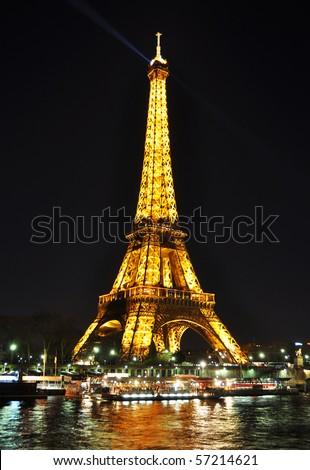 PARIS - APRIL 4: Eiffel tower at night on April 4, 2010 in Paris. The Eiffel tower is the most visited monument of France - stock photo