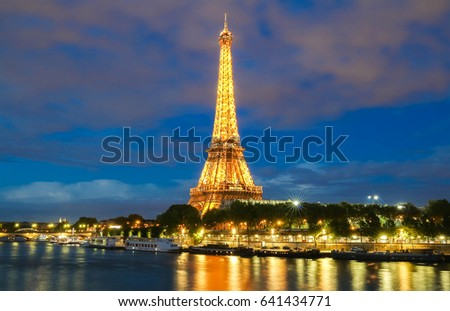 PARIS - 26 APRIL,2017: Eiffel Tower in the Dusk on April 26, 2017. The Eiffel tower is the most visited monument of France.