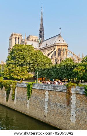 PARIS - APRIL 25: Group of tourists visits Notre Dame cathedral on April 25, 2011 in Paris. Notre Dame de Paris receives about 12 million visitors annually. - stock photo