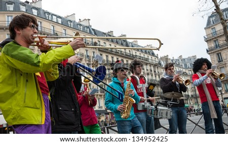 PARIS - APRIL 6: Group of young musicians as seen on April 6, 2013 in Paris, France. Dozens buskers perform on the streets and in metro of Paris. - stock photo