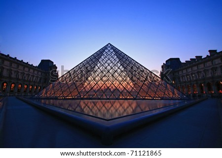 PARIS - APRIL 16: Landscape of Louvre museum at dusk during the Summer Exhibition April 16, 2010 in Paris.Louvre is the biggest Museum in Paris displayed over 60,000 square meters of exhibition space. - stock photo