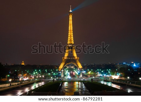 PARIS - APRIL 19 : Light Performance Show on April 19, 2010 in Paris. The Eiffel tower stands 324 metres (1,063 ft) tall. Monument was built in 1889, attendance is over 7 millions people. - stock photo