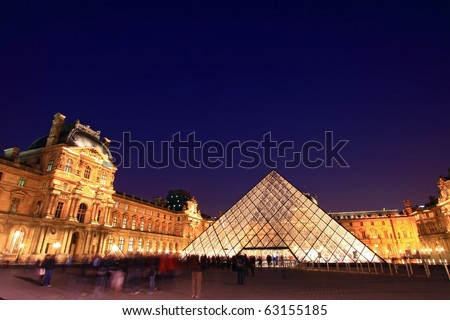 PARIS-APRIL 16: Louvre pyramid at Evening during the Summer Antiquities Exhibition April 16, 2010. The Louvre is the biggest Museum in Paris displayed over 60,000 square meters of exhibition space. - stock photo