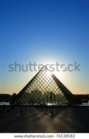 PARIS-APRIL 28: Louvre pyramid at sunset The Louvre is the biggest Museum in Paris displayed over 60,000 square meters of exhibition space. on April 28th 2011 in Paris, France - stock photo