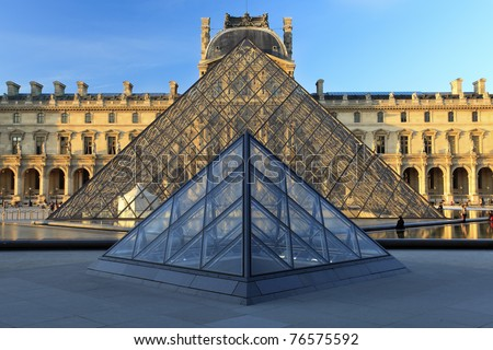 PARIS - APRIL 07: Louvre Pyramid on April 07, 2011 in Paris. Louvre is the biggest Museum in Paris displayed over 60,000 square meters of exhibition space. - stock photo