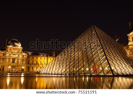 PARIS - APRIL 13: Louvre Pyramid shines at dusk during the Summer Exhibition April 13, 2011 in Paris. Louvre is the biggest Museum in Paris displaying over 60,000 square meters of exhibition space.