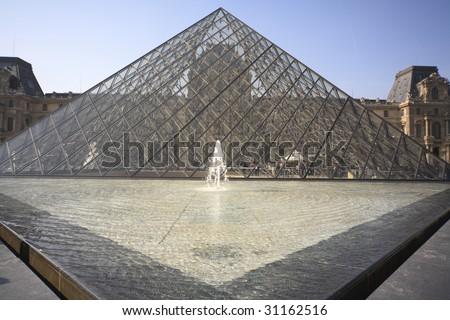 PARIS - APRIL 20: Museum du Louvre and the Pyramid April 20, 2009 in Paris France - stock photo