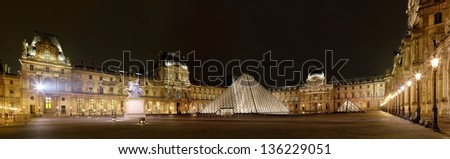 PARIS-APRIL 4: Panoramic view of Louvre Art Museum at night. The Louvre is the biggest Museum in Paris displayed over 60,000 square meters of exhibition space, on April 4, 2013 in Paris, France. - stock photo
