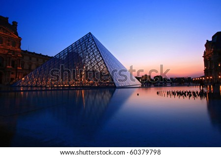 PARIS - APRIL 16: S of Louvre pyramid at Dusk during the Egyptian Antiquities Summer Exhibition April 16, 2010 in Paris. This is one of the most popular tourist destinations in France. - stock photo