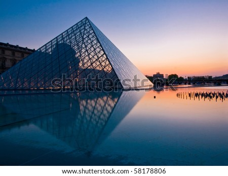 PARIS - APRIL 16: Silhouette of Louvre pyramid at Evening during the Egyptian Antiquities Exhibition April 16, 2010 in Paris. This is one of the most popular tourist destinations in France. - stock photo