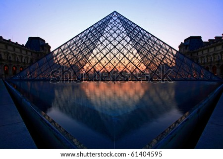 PARIS-APRIL 16: Silhouette of Louvre pyramid at Evening during the Egyptian Antiquities Exhibition April 16, 2010 in Paris. Louvre is the biggest Museum in Paris displayed over 60,000 Sqr.m of exhibition space. - stock photo