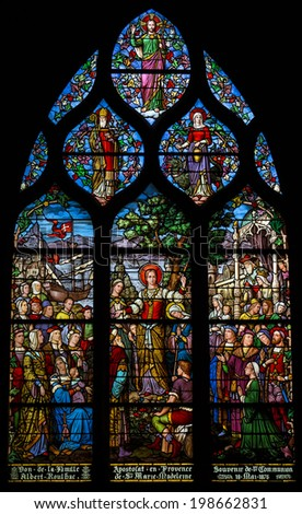 PARIS - APRIL 24: stained glass depicting St Mary Magdalene's apostleship to Provence. Shot in Church of Saint Severin, Paris, April 24, 2014. - stock photo