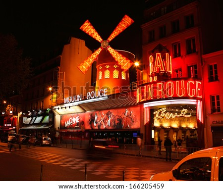 PARIS - APRIL 11: The Moulin Rouge by night, on April 11, 2011 in Paris, France. Moulin Rouge is a famous cabaret built in 1889, locating in the Paris red-light district of Pigalle  - stock photo