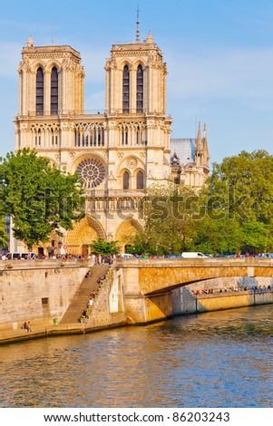 PARIS - APRIL 24: Tourists visits Notre Dame cathedral on April 24, 2011 in Paris. Notre Dame de Paris receives about 12 million visitors annually. - stock photo