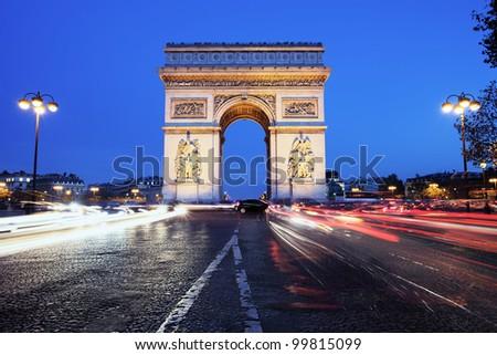 Paris, Arc de Triomphe by night - stock photo