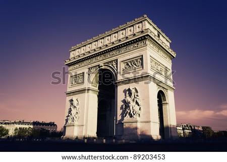 Paris, Arc de Triomphe in the evening - stock photo