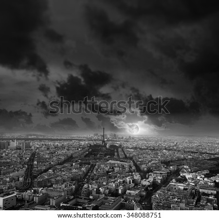 Paris at night. Moon rise with dramatic cloudscape. Black and white picture. Travel background - stock photo