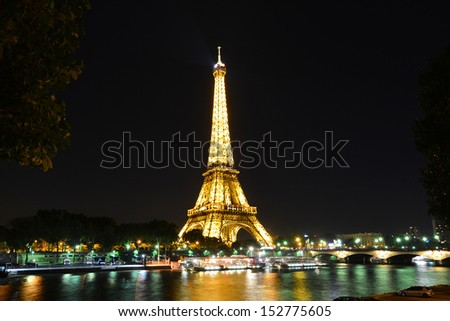 PARIS - AUG 14 : Eiffel Tower Light Performance Show in Dusk on August 14, 2013. The Eiffel tower is the most visited and the hightest monument of France.  - stock photo