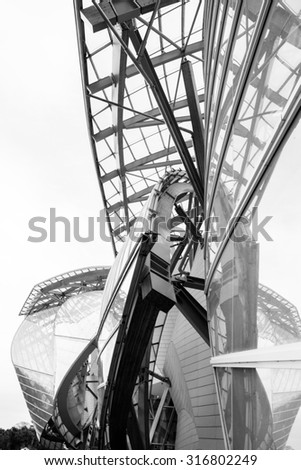 PARIS - AUGUST 29: Black and white image of the Foundation Louis Vuitton, designed by architect Frank Gehry and built in 2004 in Paris, France on 29 August 2015 - stock photo