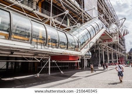PARIS - AUGUST 04: Centre Pompidou with unidentified people on August 04, 2014 in Paris, designed in style of hightech architecture by architects Richard Rogers, Renzo Piano and Gianfranco Franchini.