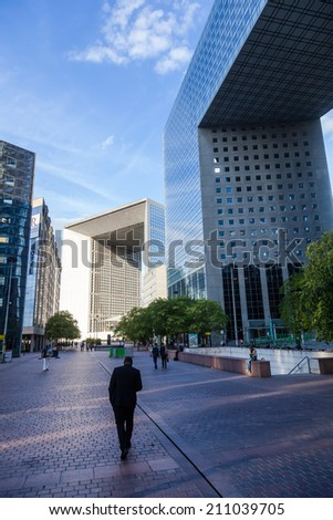 PARIS - AUGUST 05: district La Defense with unidentified people on August 05, 2014 in Paris. It is Europes largest business district with 560 hectares area 72 glass and steel buildings and skyscrapers - stock photo