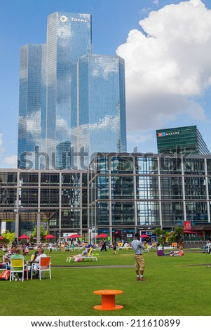 PARIS - AUGUST 05: district La Defense with unidentified people on August 05, 2014 in Paris. It is Europes largest business district with 560 hectares area 72 glass and steel buildings and skyscrapers