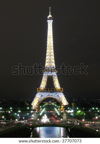 PARIS - AUGUST 8: Eiffel Tower at night August 8, 2007 in Paris, France. The Eiffel tower is the most visited monument of France  and the most recognizable landmark of the world. - stock photo