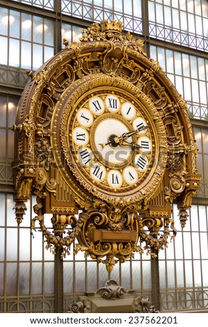 PARIS - AUGUST 21, 2013: Golden clock of the museum D'Orsay in Paris, France. Musee d'Orsay has the largest collection of impressionist and post-impressionist paintings in the world. - stock photo