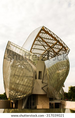 PARIS - AUGUST 29: Image of the Foundation Louis Vuitton, designed by architect Frank Gehry and built in 2004 in Paris, France on 29 August 2015 - stock photo