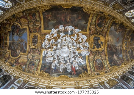 Paris - August 31: Interiors, architectural details an decorated roofs of the Chateau de Versailles on August 31, 2013 in Paris, France - stock photo