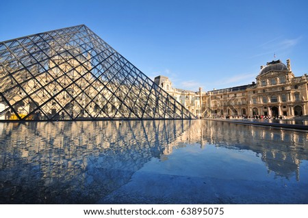 PARIS - AUGUST 24 : Louvre Museum marks 20th Anniversary of I.M. Pei's glass pyramid on August 24, 2009 in Paris, France - stock photo