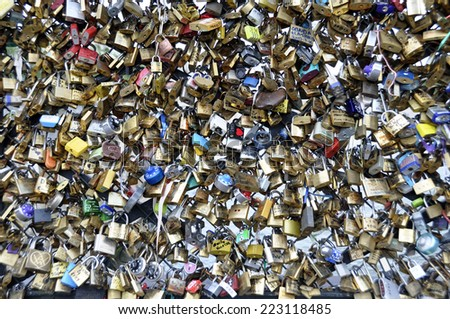 PARIS - August 20: Love Padlocks at Pont des Arts on Agust 20, 2013, in Paris. The thousands of locks of loving couples symbolize love forever. - stock photo
