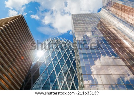 PARIS - AUGUST 05: skyscrapers in the district La Defense on August 05, 2014 in Paris. It is Europes largest business district with 560 hectares area 72 glass and steel buildings and skyscrapers - stock photo