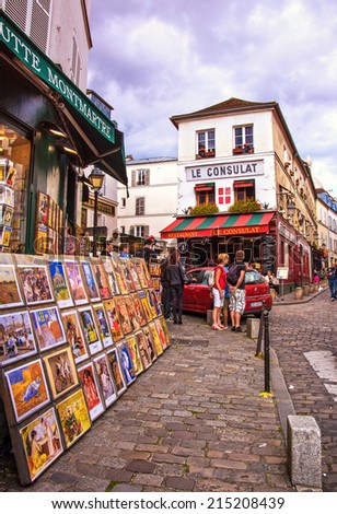 PARIS - August 16: Streets of Montmartre hill are full of art galleries, cafes and shops on August 16, 2014 in Paris, France. Montmartre area is among most popular destinations in Paris - stock photo