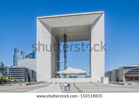 PARIS - AUGUST 1: The Grand Arch (La Grande Arche de la Defense) on August 1, 2013 in Paris, La Defense, France. The Grand Arch is the central and iconic building of La Defense. - stock photo